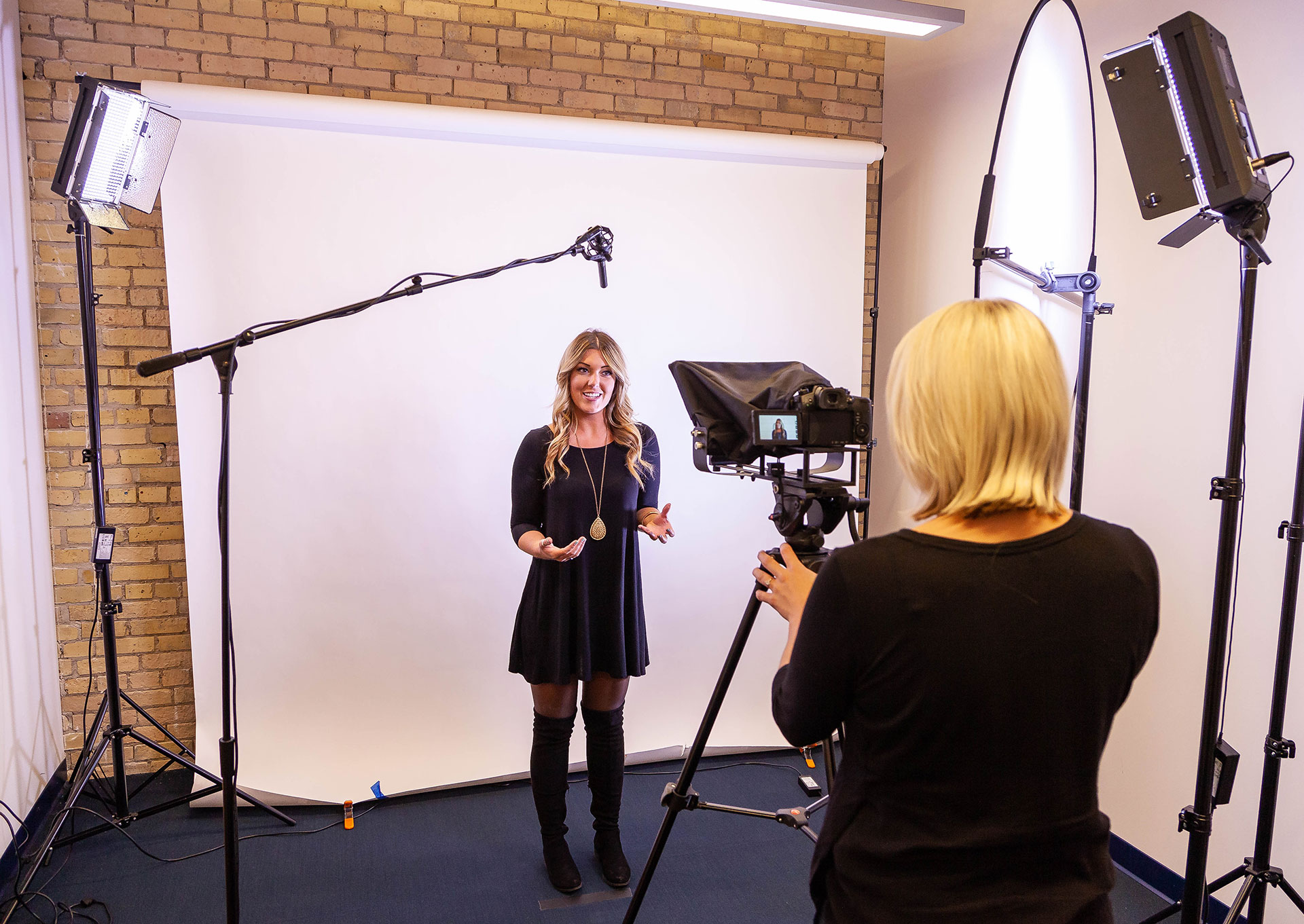 Denamico team member filming in the video studio
