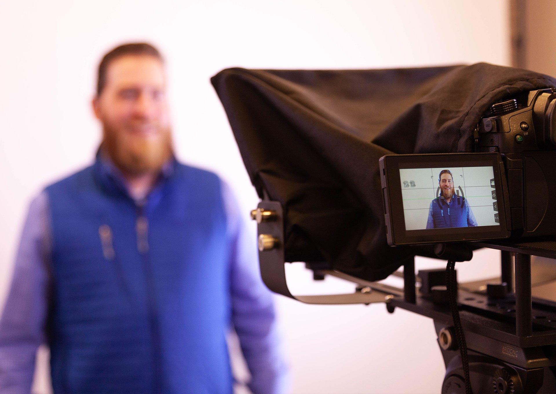 Denamico team member filming in the video studio